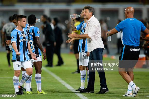 Coach Renato Gaucho of Brazil's Gremio gives instructions to his players during their Copa Libertadores 2017 football match against Venezuela's...