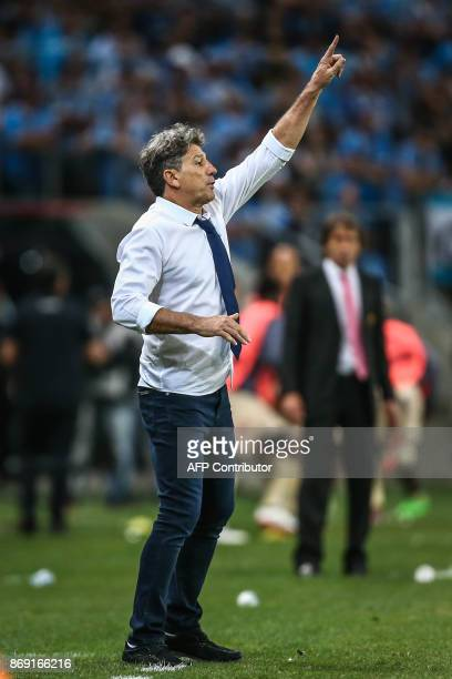 Coach Renato Gaucho of Brazil's Gremio gives instructions to his players during their Copa Libertadores football match against Ecuador's Barcelona at...