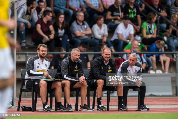 Coach Rene Maric Head Coach Marco Rose coach Alexander Zickler and coach Frank Geideck sit on the bench during the preseason friendly match between...