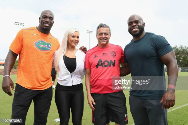 Coach Ricardo Formosinho of Manchester United pose with WWE wrestlers Apollo Crews, Dana Brooke and Titus O'Neil after a training session as part of...