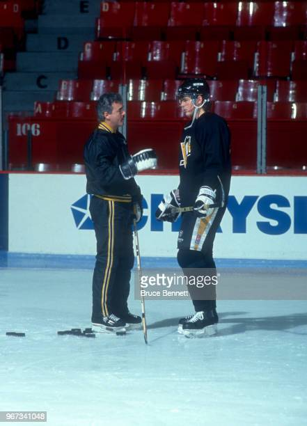 Coach Rick Kehoe of the Pittsburgh Penguins talks with Jaromir Jagr during practice before an NHL game against the Montreal Canadiens on January 6...