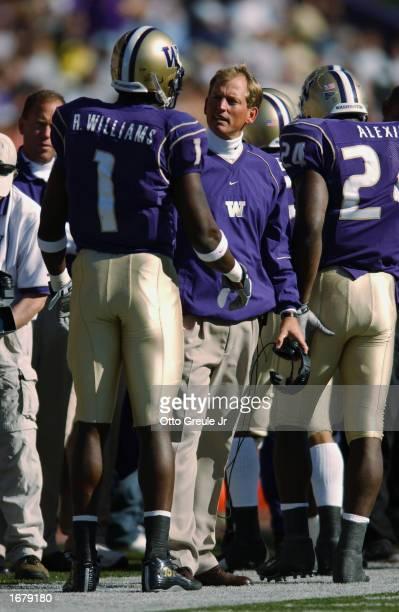 Coach Rick Neuheisel of the Washington Huskies talks to wide receiver Reggie Williams on the sideline during the NCAA football game against the...