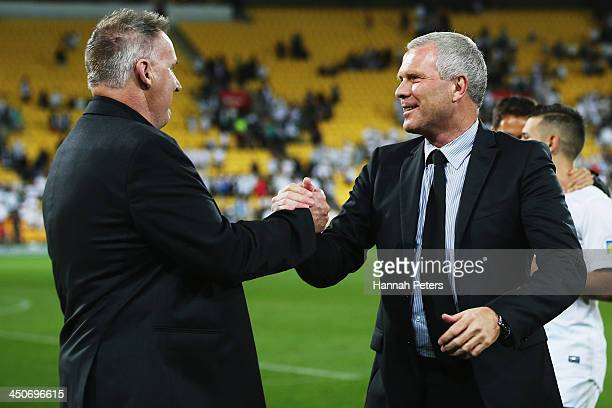 Coach Ricki Herbert of New Zealand thanks manager Brian Turner after losing leg 2 of the FIFA World Cup Qualifier match between the New Zealand All...