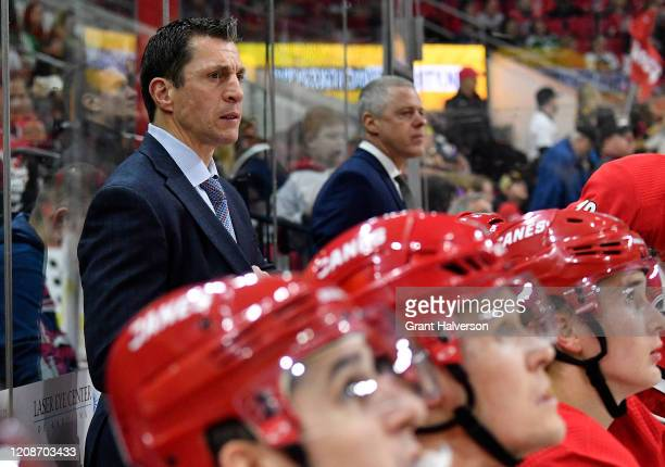 Coach Rod Brind'Amour watches his team play against the Dallas Stars during the second period of a game at PNC Arena on February 25, 2020 in Raleigh,...