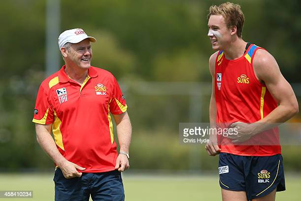 Coach Rodney Eade and Tom Lynch talk during a Gold Coast Suns training session at Metricon Stadium on November 5 2014 in Gold Coast Australia