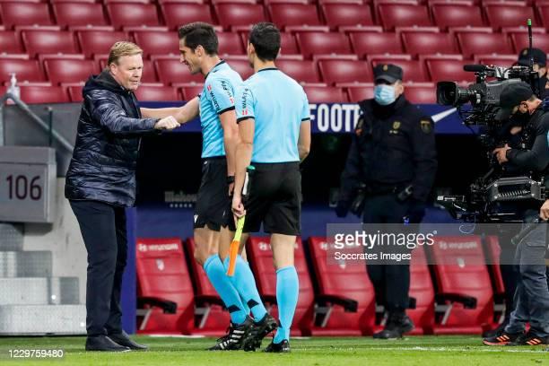 coach Ronald Koeman of FC Barcelona referee Jose Luis Munuera Montero during the La Liga Santander match between Atletico Madrid v FC Barcelona at...