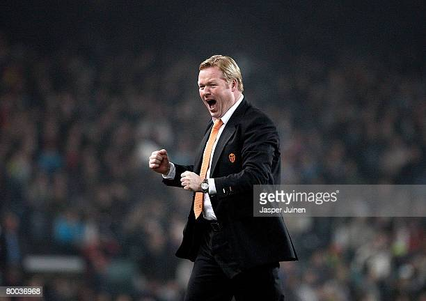 Coach Ronald Koeman of Valencia celebrates his team's goal during the Copa del Rey semi final match between Barcelona and Valencia at the Camp Nou...