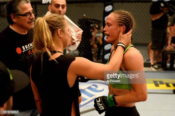 Coach Ronda Rousey congratulates Jessica Rakoczy in her corner after defeating Roxanne Modafferi in their preliminary fight during filming of season...