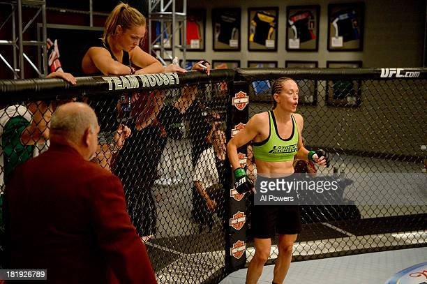 Coach Ronda Rousey looks over Jessica Rakoczy in her corner before her bout against Roxanne Modafferi in their preliminary fight during filming of...