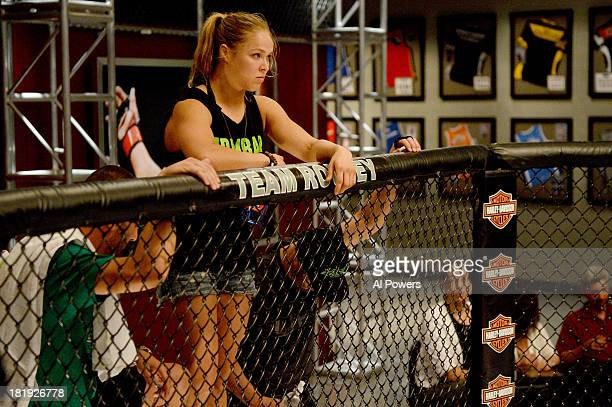 Coach Ronda Rousey looks over the Octagon prior to the bout between Jessica Rakoczy and Roxanne Modafferi in their preliminary fight during filming...