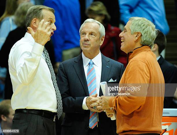 Coach Roy Williams of the North Carolina Tar Heels and coach Rick Barnes of the Texas Longhorns talk before their game at the Dean Smith Center on...