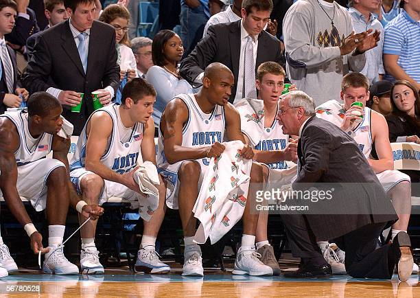 Coach Roy Williams of the North Carolina Tar Heels talks to his starting lineup of David Noel Wes Miller Reyshawn Terry Tyler Hansbrough and Bobby...