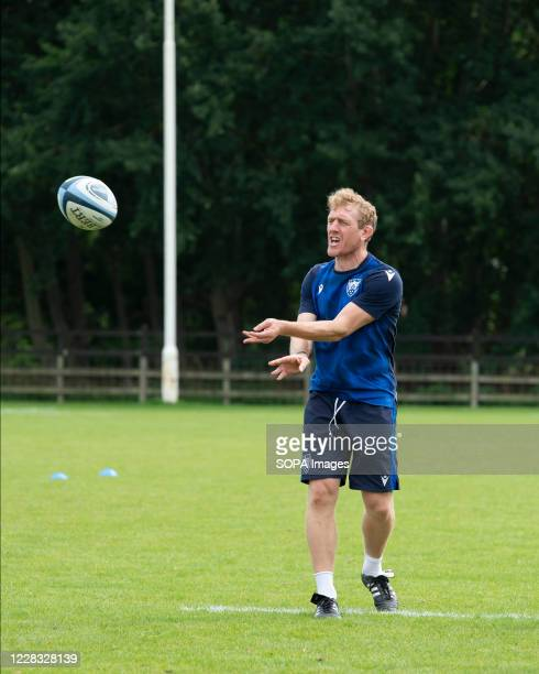 Coach Sam Vesty issues instructions during the Northampton Saints training session at Franklin's Gardens