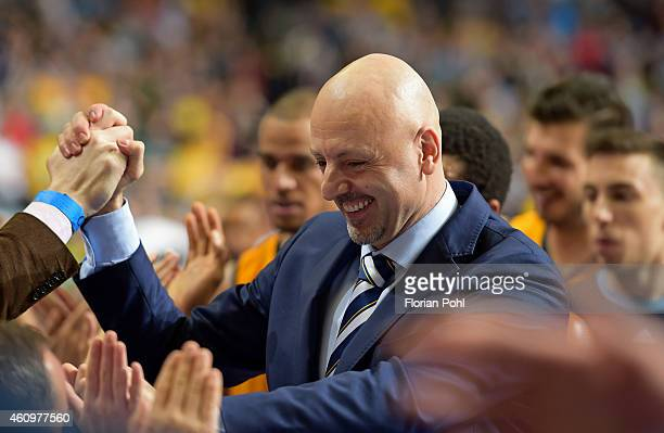 Coach Sasa Obradovic of ALBA Berlin celebrates the home victory with the fans during the game between Alba Berlin and FC Barcelona on january 2, 2015...