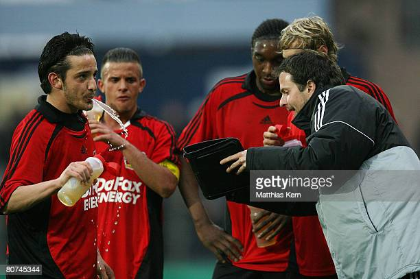 Coach Sascha Lewandowski of Leverkusen speaks with his players during the Juniors Cup Final match between Borussia Moenchengladbach and Bayer 04...