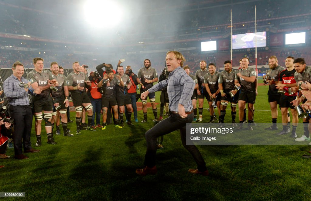 Coach Scott Robertson of the Crusaders dances for his players as Crusaders are crowned the 2017 Super Rugby champions during the Super Rugby Final match between Emirates Lions and Crusaders at Emirates Airline Park on August 05, 2017 in Johannesburg, South Africa.