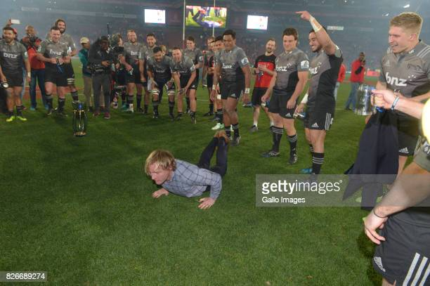 Coach Scott Robertson of the Crusaders dances for his players as Crusaders are crowned the 2017 Super Rugby champions during the Super Rugby Final...