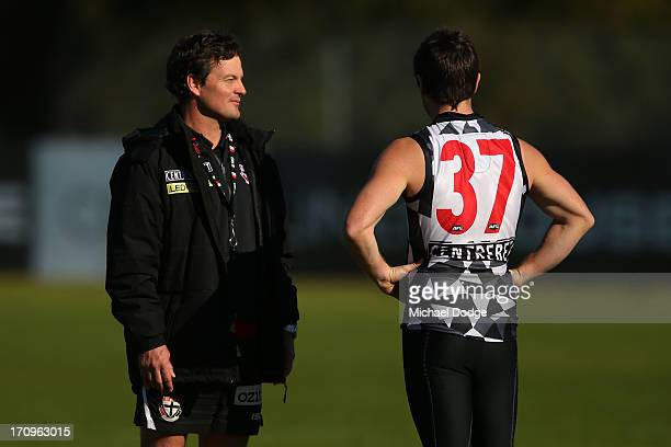 Coach Scott Watters and Stephen Milne talk during a St Kilda Saints AFL training session at Linen House Oval on June 21 2013 in Melbourne Australia