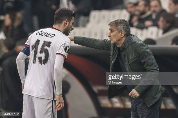 coach Senol Gunes of Besiktas JK give instructions to Oguzhan Ozyakup of Besiktas JKduring the UEFA Europa League round of 16 match between Besiktas...