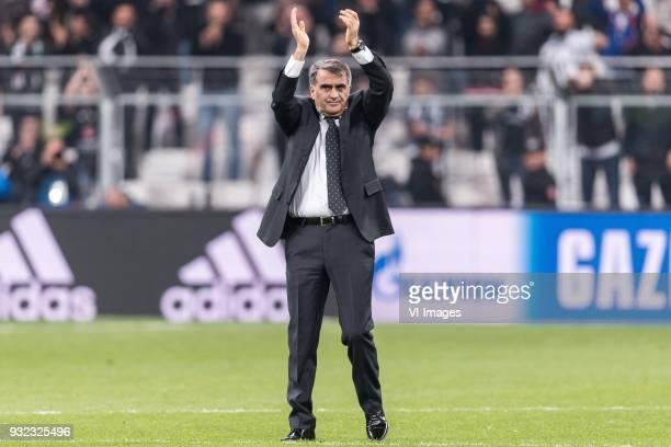 coach Senol Gunes of Besiktas JK thank the supporters during the UEFA Champions League round of 16 match between Besiktas AS and Bayern Munchen at...