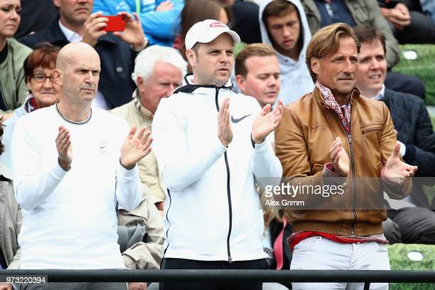 Coach Severin Luethi applauds as Roger Federer of Switzerland defeats Mischa Zverev of Germany during day 3 of the Mercedes Cup at Tennisclub...