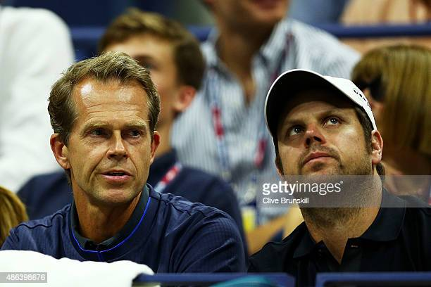 Coach Stefan Edberg and Severin Luthi watch Roger Federer of Switzerland play Steve Darcis of Belgium during their Men's Singles Second Round match...