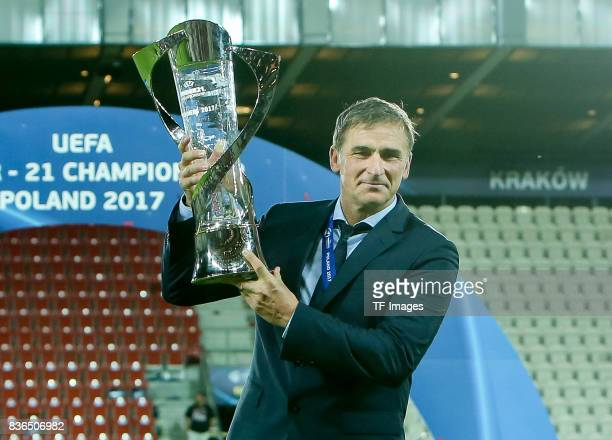 Coach Stefan Kuntz of Germany celebrates with the trophy after the UEFA U21 Final match between Germany and Spain at Krakow Stadium on June 30 2017...