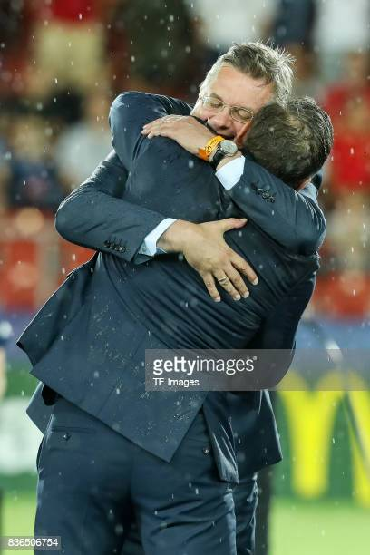 Coach Stefan Kuntz of Germany shakes hands with Reinhard Grindel during the UEFA U21 Final match between Germany and Spain at Krakow Stadium on June...