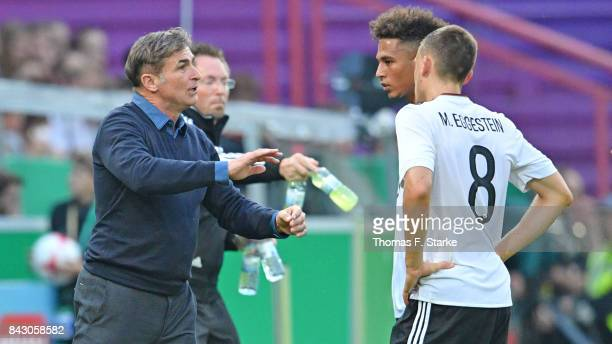 Coach Stefan Kuntz of Germany talks to his playes Thilo Kehrer and Maximilian Eggestein during the UEFA Euro 2019 Qualifier match between Germany U21...