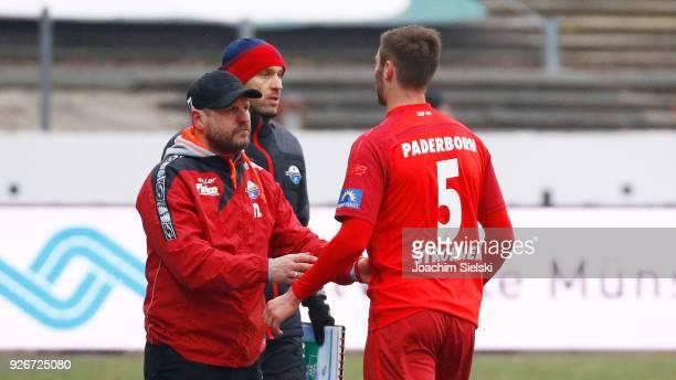 Coach Steffen Baumgart talk to Christian Strohdiek of Paderborn after his yellowred card during the 3 Liga match between SC Preussen Muenster and SC...