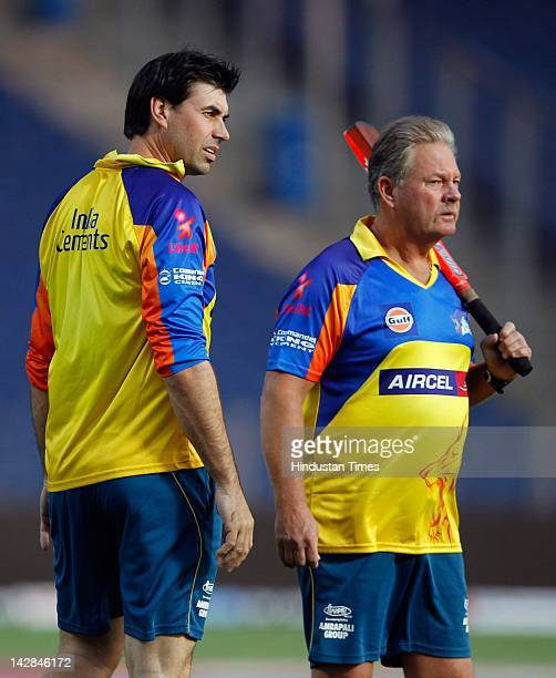 Coach Stephen Fleming of Chennai Super Kings looks on with fielding coach Steve Rixon during the net practice session at Subrata Roy Sahahra Stadium...