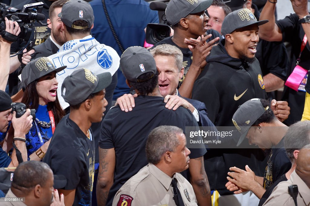 OH - Coach Steve Kerr celebrates with Nick Young #6 and the Golden State Warriors after they pick up a victory against Cleveland Cavaliers in Game Four of the 2018 NBA Finals on June 8, 2018 at Quicken Loans Arena in Cleveland, Ohio.