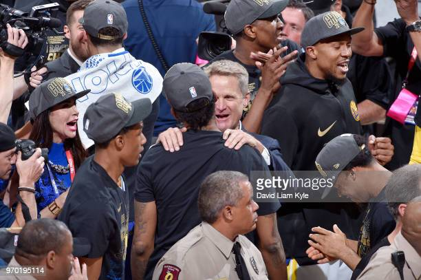 OH Coach Steve Kerr celebrates with Nick Young and the Golden State Warriors after they pick up a victory against Cleveland Cavaliers in Game Four of...