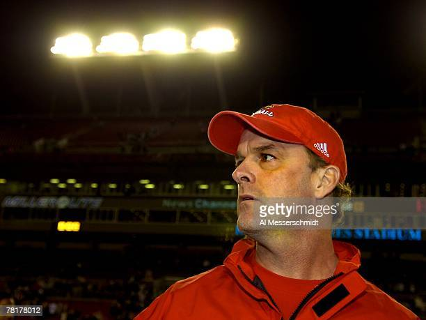 Coach Steve Kragthorpe of the Louisville Cardinals directs play against the University of South Florida Bulls at Raymond James Stadium on November 17...
