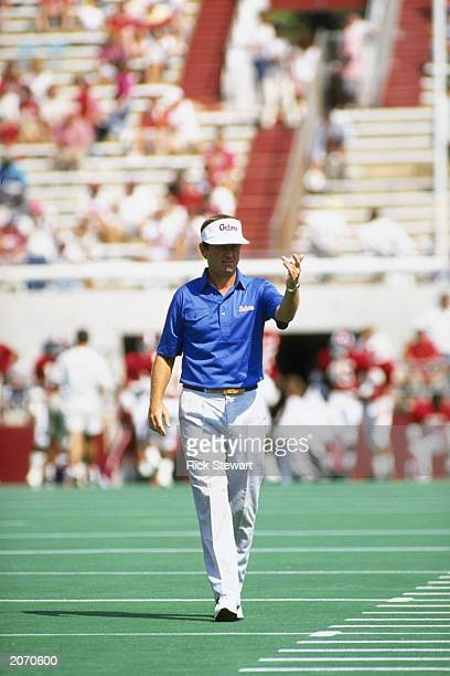 Coach Steve Spurrier of the Florida Gators walks on the field during the NCAA football game against the Alabama Crimson Tide at BryantDenny Stadium...