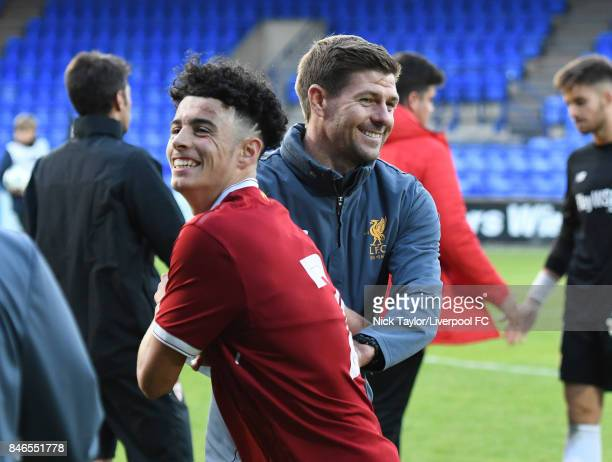 Coach Steven Gerrard celebrates with his player Curtis Jones of Liverpool after the UEFA Champions League group E match between Liverpool FC and...