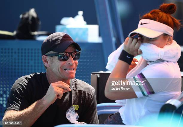 Coach Sylvain Bruneau speaks with Bianca Andreescu of Canada in her match against Sofia Kenin of USA during day five of the Miami Open Tennis on...