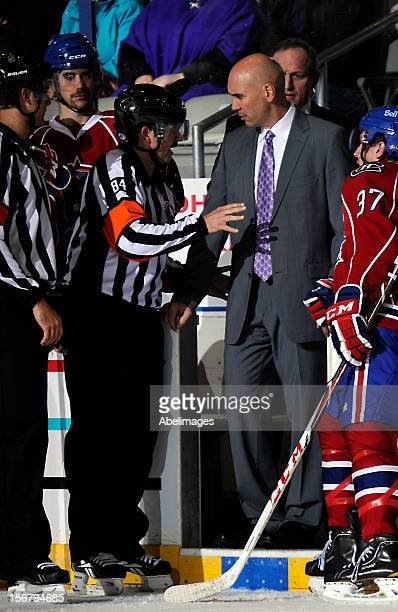 Coach Sylvain Lefebvre of the Hamilton Bulldogs gets an explanation from referee Jamie Koharski against the Toronto Marlies during AHL game action...