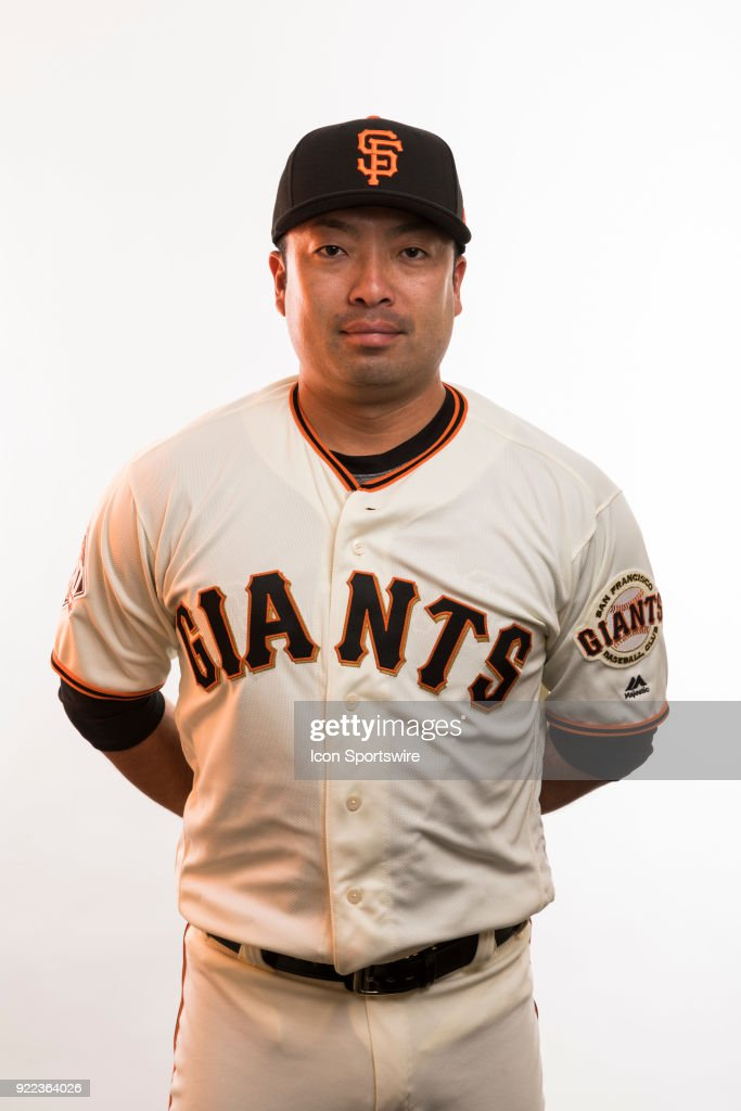 Coach Taira Uematsu (99) poses for a photo during the San Francisco Giants photo day on Tuesday, Feb. 20, 2018 at Scottsdale Stadium in Scottsdale, Ariz.
