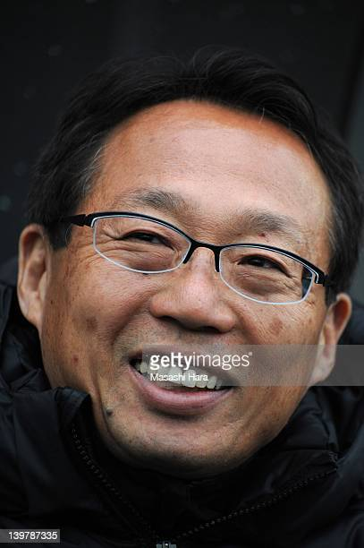 Coach Takeshi Okada of Hangzhou Greentown smiles prior to the preseason friendly match between Omiya Ardija and Hangzhou Greentown at Nack 5 Stadium...