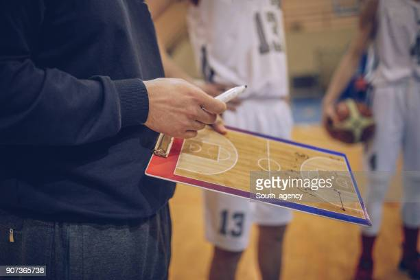 coach talking to a basketball players - match sport stock pictures, royalty-free photos & images