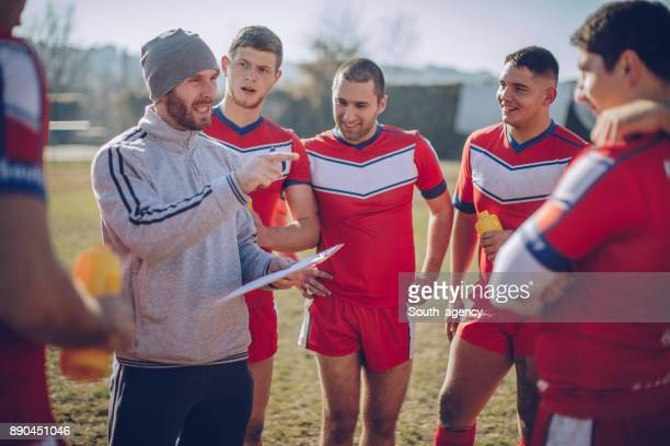 coach talking to a group of players - pep talk stock pictures, royalty-free photos & images