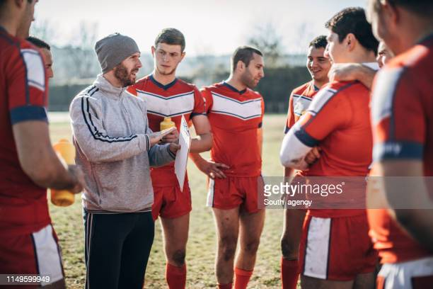 coach talking to a group of rugby players - pep talk stock pictures, royalty-free photos & images