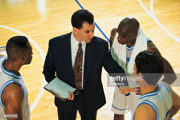 Coach talking to basketball team