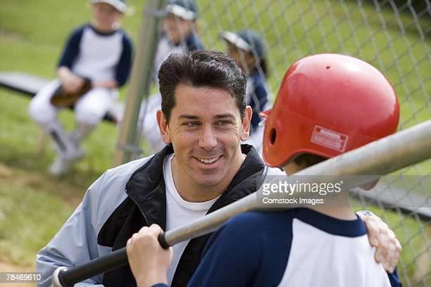 coach talking to little league batter - pep talk stock pictures, royalty-free photos & images