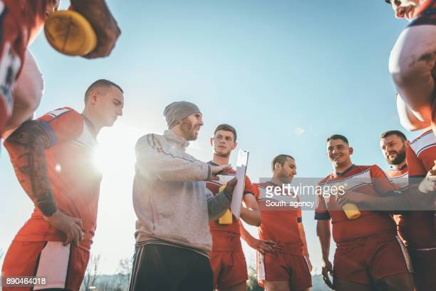 coach talking to players during time out - coach stock pictures, royalty-free photos & images