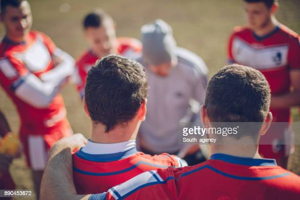 coach talking to players - pep talk stock pictures, royalty-free photos & images