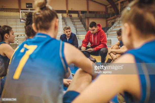 coach talking to players - coach stock pictures, royalty-free photos & images