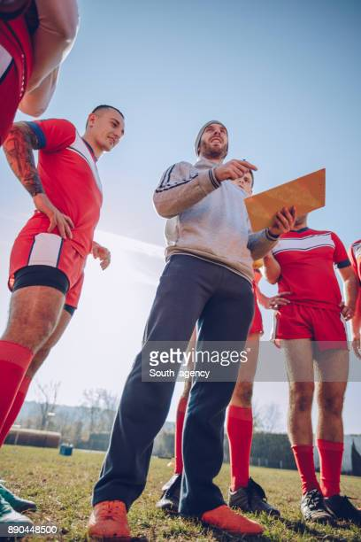 coach talking to team during time out - pep talk stock pictures, royalty-free photos & images