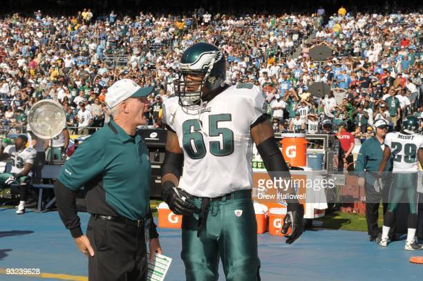 Coach Ted Daisher of the Philadelphia talks with offensive tackle King Dunlap Eagles during the game against the San Diego Chargers on November 15,...